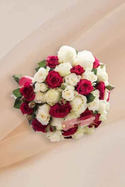 Ivory and Red Roses Bridal Bouquet - Floral design